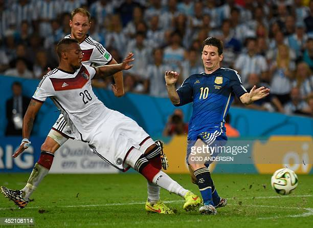 Germany's defender Jerome Boateng and Argentina's forward and captain Lionel Messi vie for the ball during the second half of the 2014 FIFA World Cup...