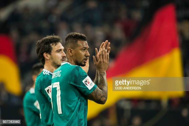 Germany's defender Jerome Boateng and Germany's defender Mats Hummels acknowledge fans after the international friendly football match of Germany vs...