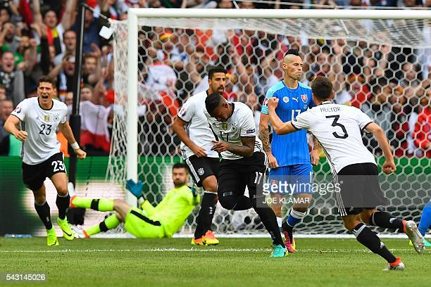 Germany's defender Jerome Boateng celebrates after scoring a goal during the Euro 2016 round of 16 football match between Germany and Slovakia at the...