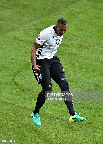 Germany's defender Jerome Boateng celebrates after scoring during the Euro 2016 round of 16 football match between Germany and Slovakia at the...