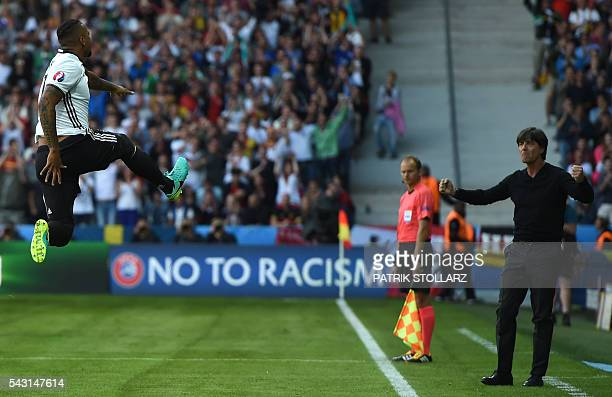 Germany's defender Jerome Boateng celebrates with Germany's coach Joachim Loew after scoring a goal during the Euro 2016 round of 16 football match...