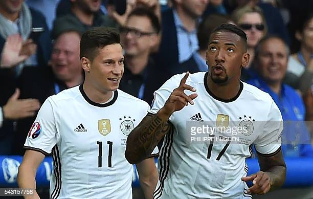 Germany's defender Jerome Boateng celebrates with Germany's midfielder Julian Draxler after scoring during the Euro 2016 round of 16 football match...