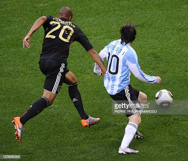 Germany's defender Jerome Boateng challenges Argentina's striker Lionel Messi for the ball during the 2010 World Cup quarterfinal football match...