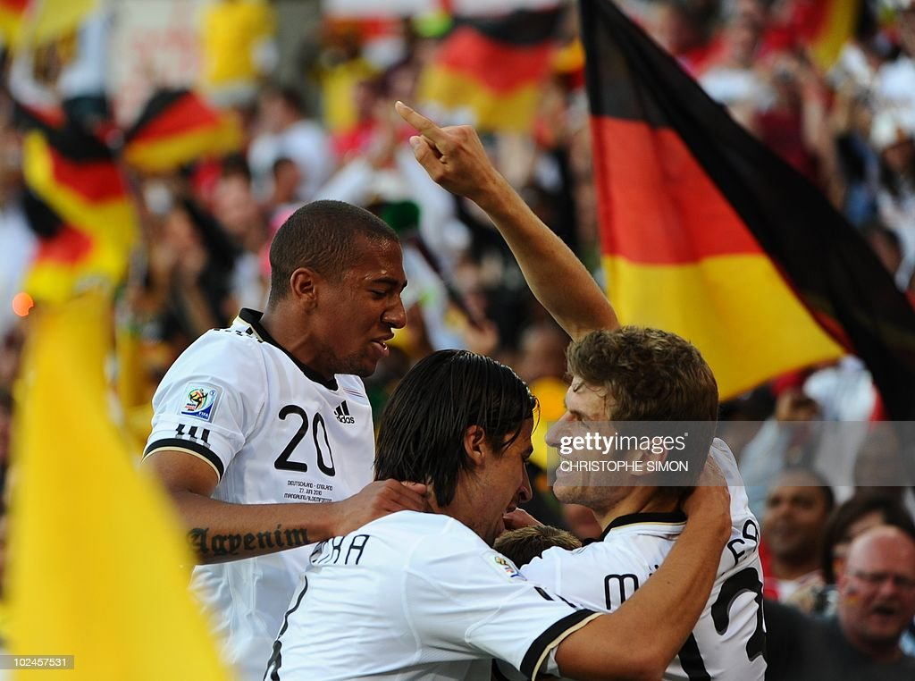 Germany's defender Jerome Boateng, Germany's midfielder Sami Khedira and Germany's midfielder Thomas Mueller celebrate after Germany's striker Lukas Podolski (unseen) scored during the 2010 World Cup round of 16 football match England versus Germany on June 27, 2010 at Free State Stadium in Mangaung/Bloemfontein. NO