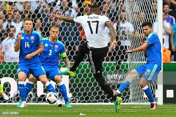 Germany's defender Jerome Boateng kicks the ball to score a goal during the Euro 2016 round of 16 football match between Germany and Slovakia at the...