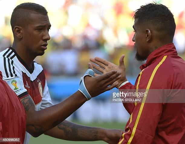 Germany's defender Jerome Boateng shakes hands with his brother Ghana's forward KevinPrince Boateng prior to a Group G football match between Germany...