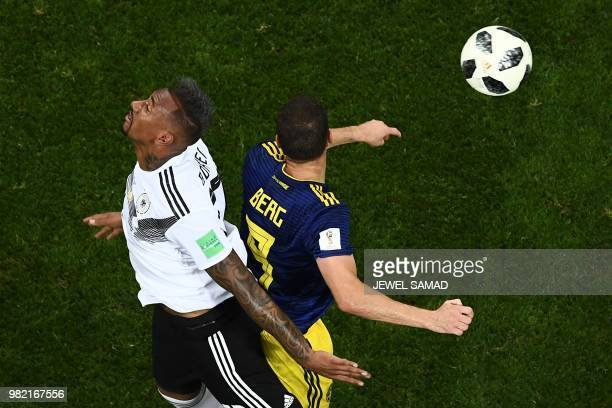 TOPSHOT Germany's defender Jerome Boateng vies for the header with Sweden's forward Marcus Berg during the Russia 2018 World Cup Group F football...