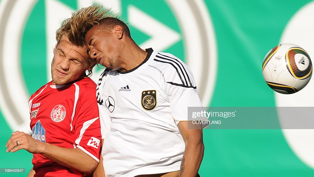 Germany's defender Jerome Boateng (R) vies with Suedtirol's Filippo Bigesmi during a training match Germany vs Sued Tyrol FC at the team's training centre in Appiano, near the north Italian city of Bolzano May 24, 2010. The German football team is currently taking part in a 12-day training camp in Appiano to prepare for the upcoming FIFA Football World Cup in South Africa.