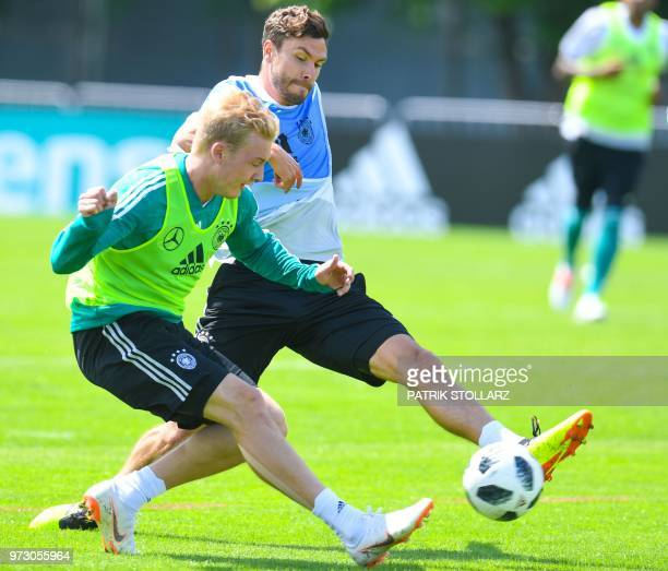 Germany's defender Jonas Hector and midfielder Julian Brandt vie for the ball during a training session in Vatutinki near Moscow on June 13 ahead of...