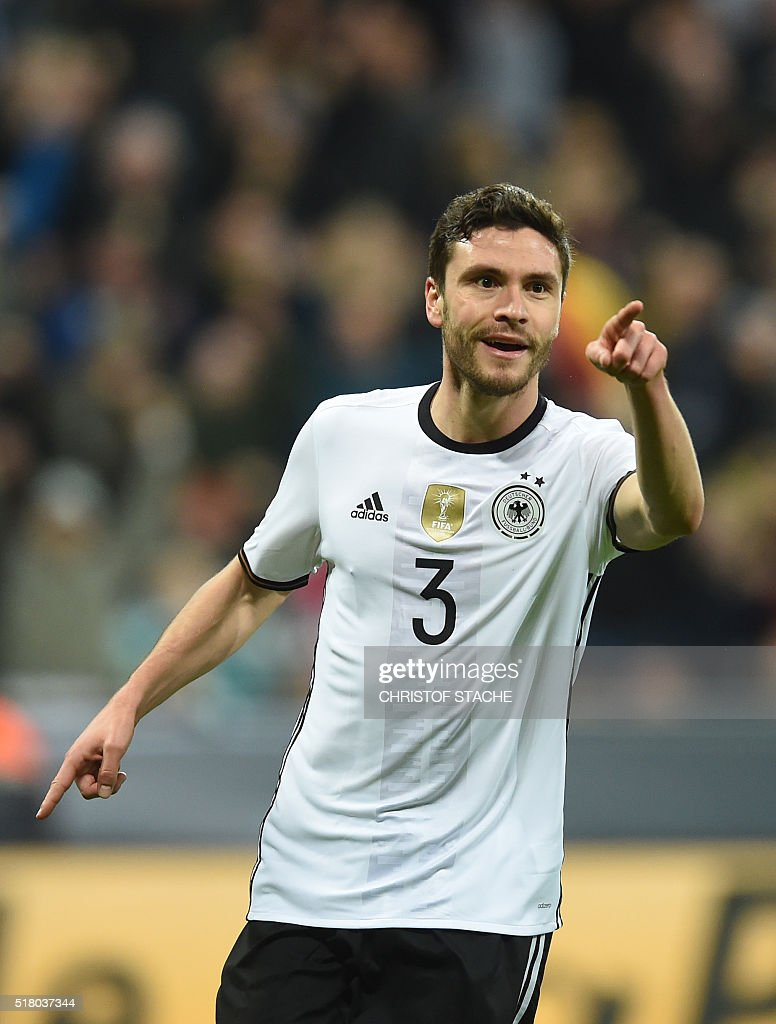 Germany's defender Jonas Hector celebrates scoring the 3-0, his first goal for Germany during the friendly football match Germany vs Italy in Muinch, southern Germany, on March 29, 2016. / AFP / CHRISTOF