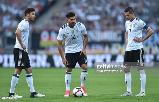 Germany's defender Jonas Hector Germany's midfielder Emre Can and Germany's midfielder Julian Draxler prepare a free kick during the WC 2018...