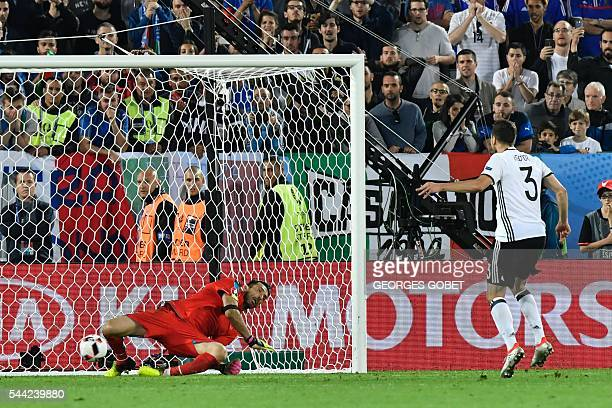 TOPSHOT Germany's defender Jonas Hector scores the last penalty kick during the Euro 2016 quarterfinal football match between Germany and Italy at...