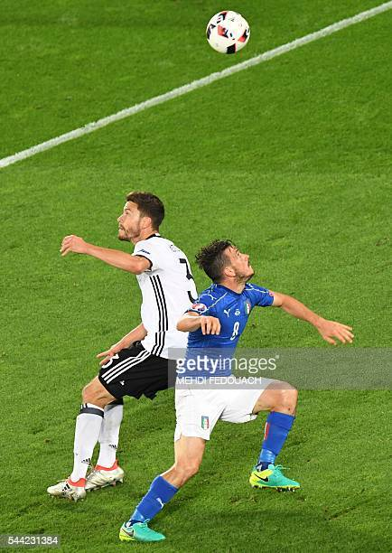 Germany's defender Jonas Hector vies for the ball with Italy's midfielder Alessandro Florenzi during the Euro 2016 quarterfinal football match...