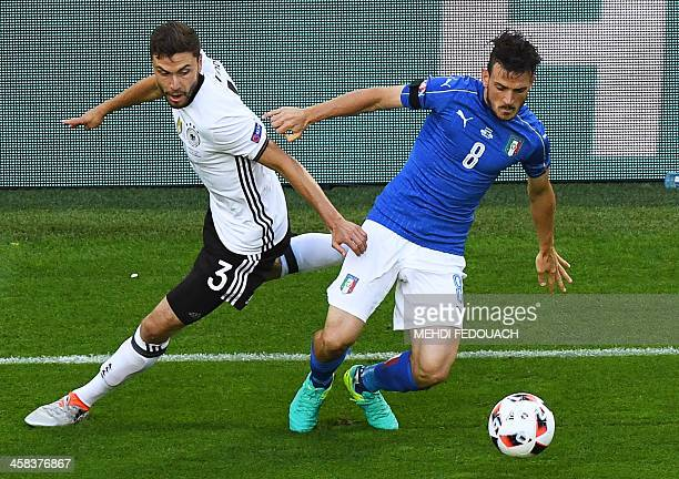 Germany's defender Jonas Hector vies with Italy's midfielder Alessandro Florenzi during the Euro 2016 quarterfinal football match between Germany and...