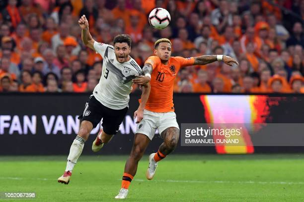 Germany's defender Jonas Hector vies with Netherlands' forward Memphis Depay during the UEFA Nations League football match between Netherlands and...