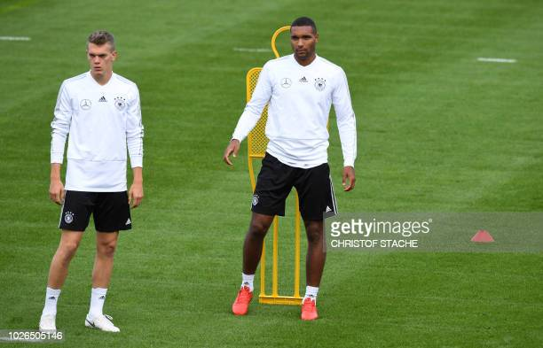 Germany's defender Jonathan Tah and Germany's defender Matthias Ginter attend a training session of the German national football team in Munich...