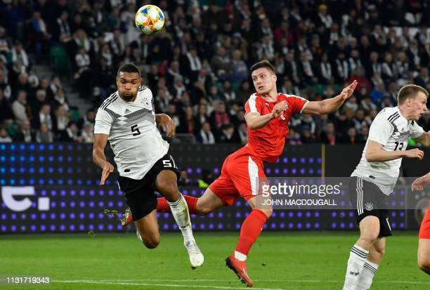 Germany's defender Jonathan Tah and Serbia's forward Luka Jovic vie for the ball during the friendly football match Germany v Serbia in Wolfsburg...