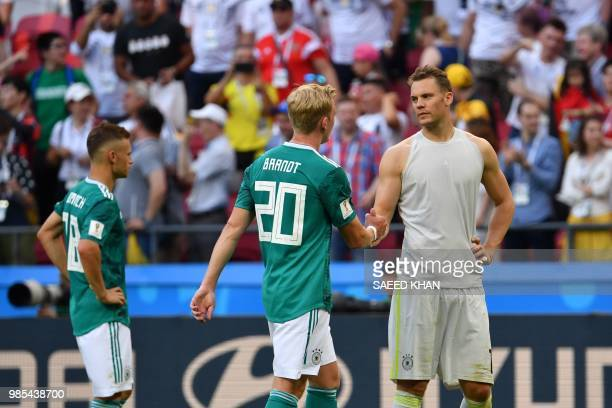 Germany's defender Joshua Kimmich Germany's forward Julian Brandt and Germany's goalkeeper Manuel Neuer react at the end of the Russia 2018 World Cup...