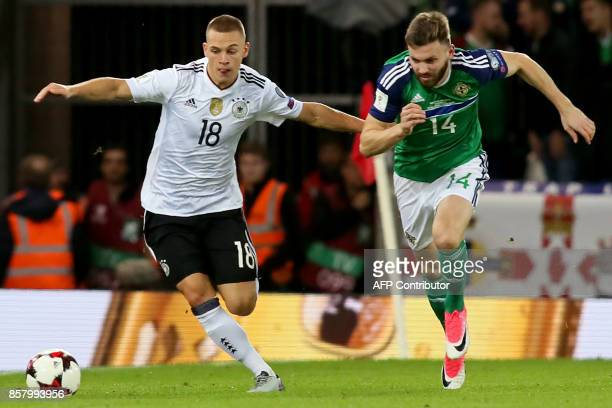 Germany's defender Joshua Kimmich vies with Northern Ireland's midfielder Stuart Dallas during the FIFA World Cup 2018 qualification football match...