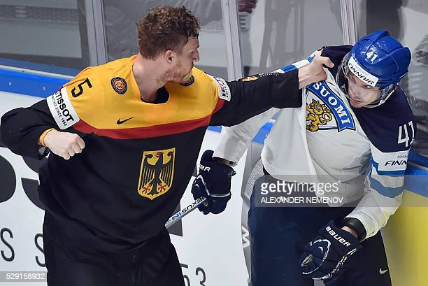 Germany's defender Korbinian Holzer fights with Finland's forward Antti Pihlstrom during the group B preliminary round game Finland vs Germany at the...