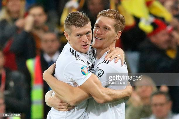 Germany's defender Marcel Halstenberg celebrates with Germany's midfielder Toni Kroos after scoring the opening goal during the the Euro 2020...