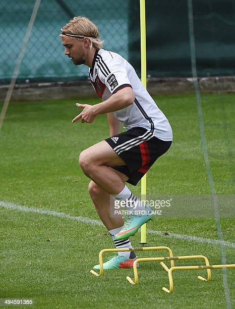 Germany´s defender Marcell Schmelzer warms up during a training session of the German national football team on a training ground in San Martino in...