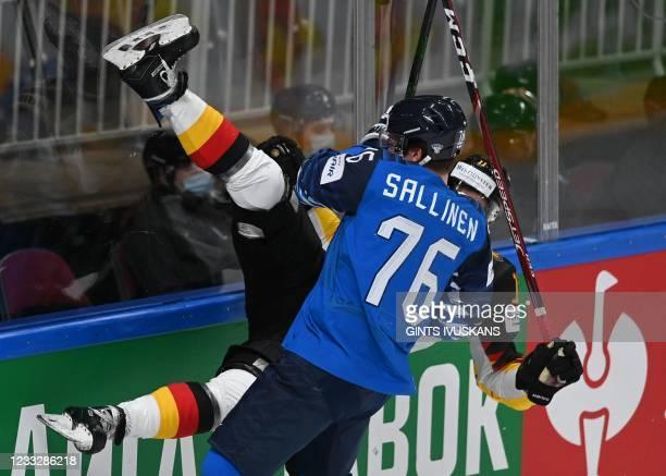 Germany's defender Marco Nowak Finland's forward Jere Sallinen vie during the IIHF Men's Ice Hockey World Championships semi-final match between the...