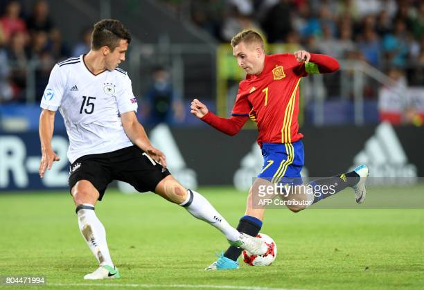 Germany's defender MarcOliver Kempf and Spain's midfielder Gerard Deulofeu vie for the ball during the UEFA U21 European Championship football final...