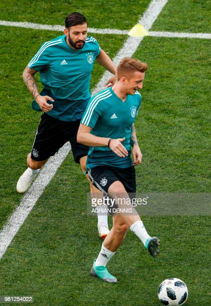 Germany's defender Marvin Plattenhardt and Germany's forward Marco Reus attend a training session at the Fisht Olympic Stadium in Sochi on June 22 on...