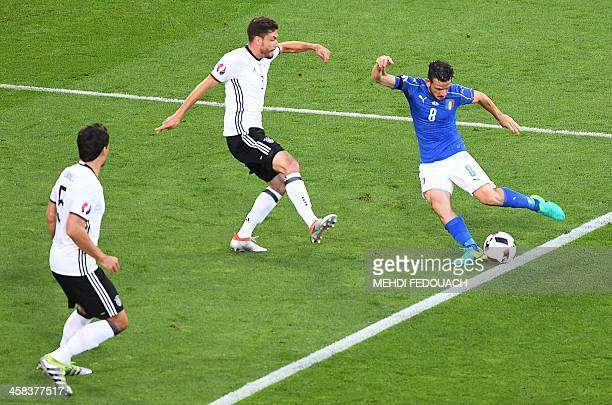 Germany's defender Mats Hummels and Germany's defender Jonas Hector vie for the ball woth Italy's midfielder Alessandro Florenzi during the Euro 2016...