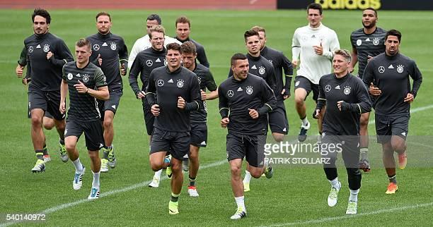 Germany's defender Mats Hummels Germany's midfielder Toni Kroos Germany's forward Mario Gomez Germany's forward Lukas Podolski Germany's midfielder...
