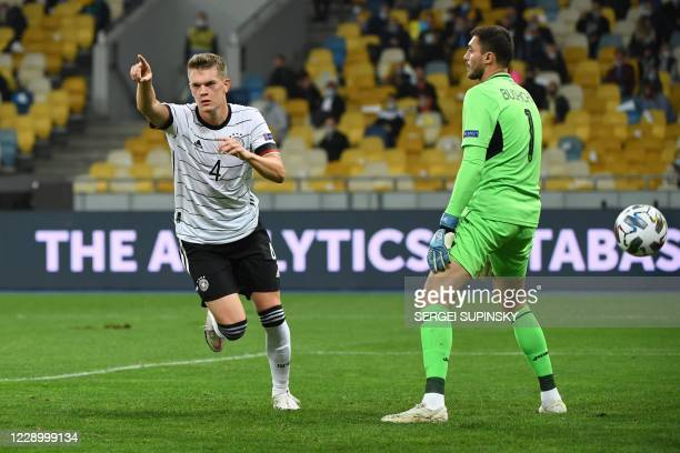 Germany's defender Matthias Ginter celebrates after scoring the opening goal during the UEFA Nations League football match between Ukraine and...