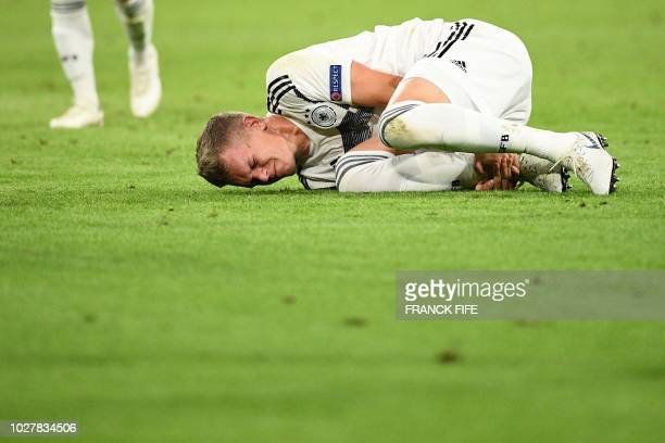 Germany's defender Matthias Ginter grimaces after being injured during the UEFA Nations League football match Germany against France on September 6...