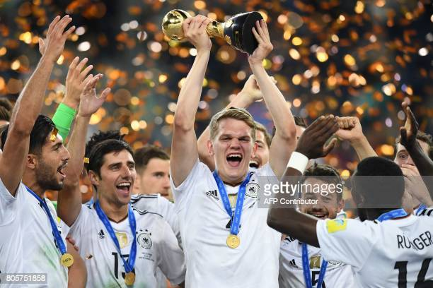 Germany's defender Matthias Ginter lifts the trophy after winning the 2017 Confederations Cup final football match between Chile and Germany at the...