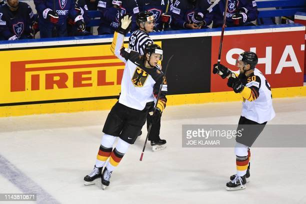 Germany's defender Moritz Seider celebrates scoring with his team-mate forward Patrick Hager during the IIHF Men's Ice Hockey World Championships...