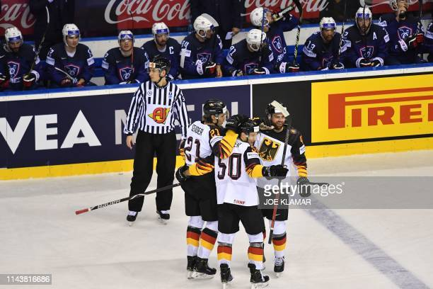 Germany's defender Moritz Seider celebrates scoring with his teammates during the IIHF Men's Ice Hockey World Championships Group A match between...