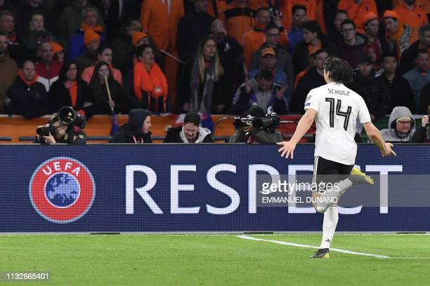 Germany's defender Nico Schulz celebrates after scoring their third goal during the UEFA Euro 2020 Group C qualification football match between The...