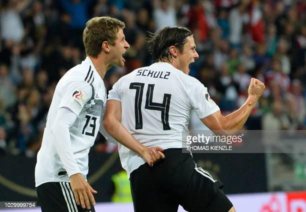 TOPSHOT Germany's defender Nico Schulz celebrates scoring the 21 during the international friendly football match Germany versus Peru on September 9...