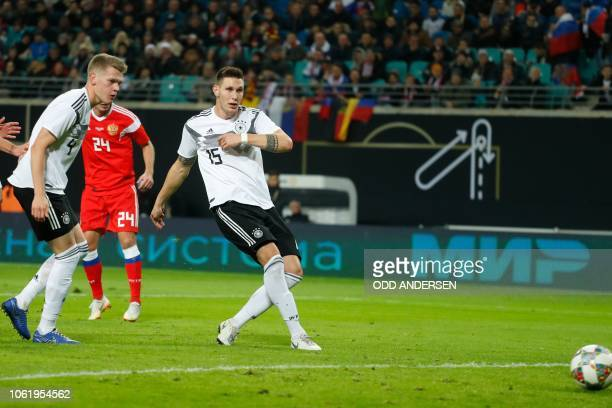 Germany's defender Niklas Suele scores the 2-0 during international friendly football match Germany v Russia in Leipzig, eastern Germany on November...