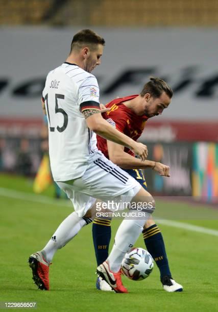 Germany's defender Niklas Suele vies with Spain's midfielder Fabian Ruiz during the UEFA Nations League footbal match between Spain and Germany at La...