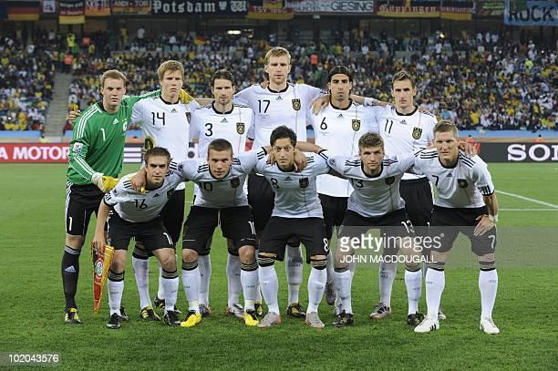 Germany's defender Philipp Lahm Germany's striker Lukas Podolski Germany's midfielder Mesut Oezil Germany's striker Thomas Mueller and Germany's...