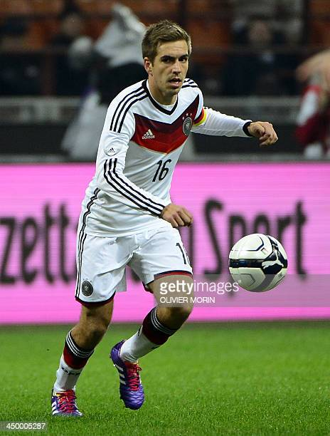 Germany's defender Philipp Lahm runs with the ball during a FIFA World Cup friendly football match between Italy and Germany on November 15 2013 at...
