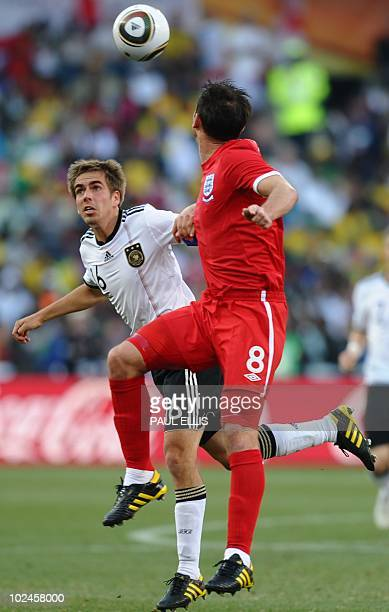 Germany's defender Philipp Lahm vies with England's midfielder Frank Lampard during the 2010 World Cup round of 16 match Germany vs England on June...