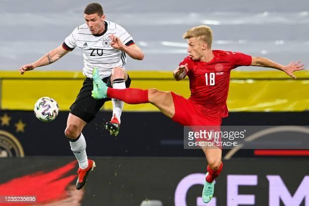Germany's defender Robin Gosens and Denmark's defender Daniel Wass vie for the ball during the friendly football match Germany v Denmark in...