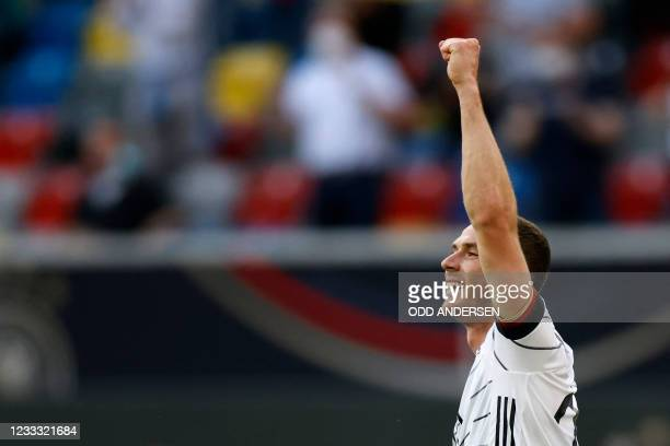 Germany's defender Robin Gosens celebrates after scoring the opening goal during the friendly football match between Germany and Latvia in...