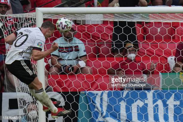 Germany's defender Robin Gosens scores their fourth goal during the UEFA EURO 2020 Group F football match between Portugal and Germany at Allianz...