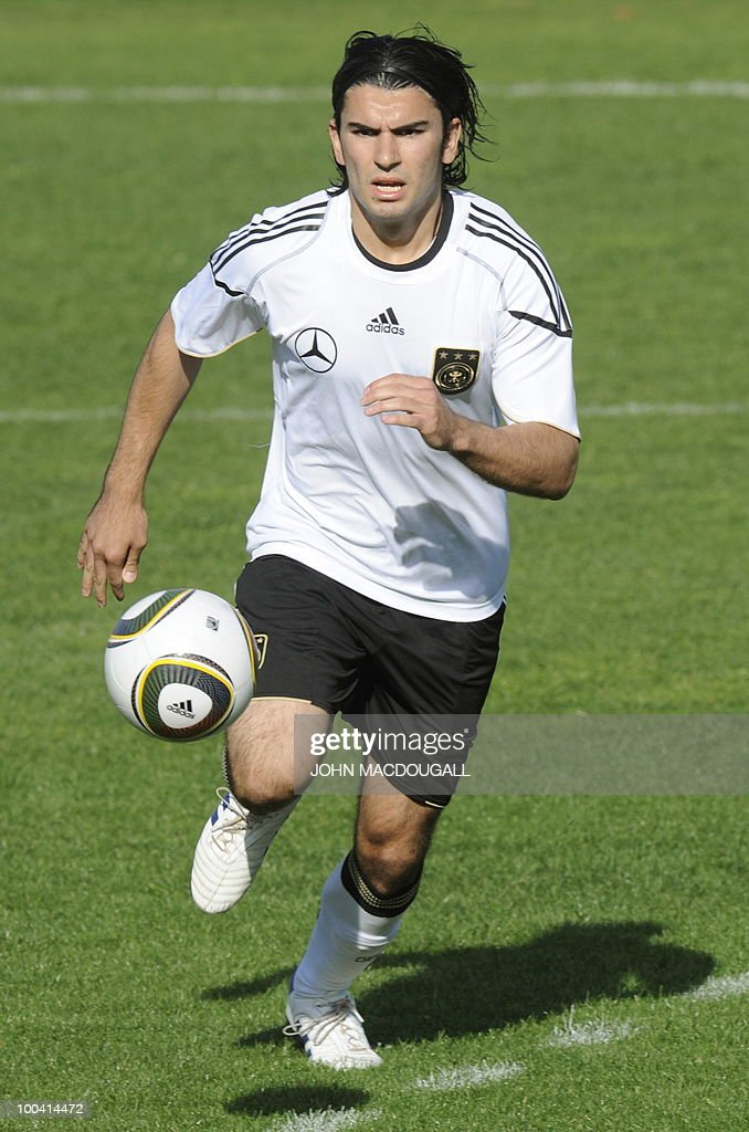 Germany's defender Serdar Tasci runs with the ball during a training match Germany against Sued Tyrol FC at the team's training centre in Appiano, near the north Italian city of Bolzano May 24, 2010. The German football team is currently taking part in a 12-day training camp in Appiano to prepare for the upcoming FIFA Football World Cup in South Africa.