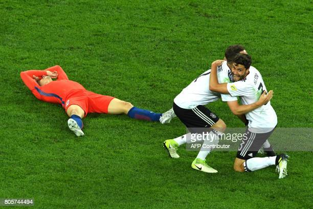 TOPSHOT Germany's defender Shkodran Mustafi celebrates with Germany's defender Jonas Hector after beating Chile 10 in the 2017 Confederations Cup...