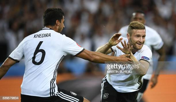 TOPSHOT Germany's defender Shkodran Mustafi celebrates with Germany's midfielder Sami Khedira after scoring a goal during the Euro 2016 group C...