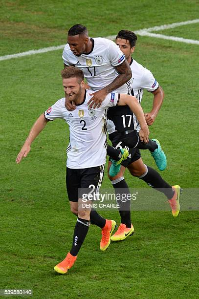 Germany's defender Shkodran Mustafi is congratulated by teammates after scoring a goal during the Euro 2016 group C football match between Germany...